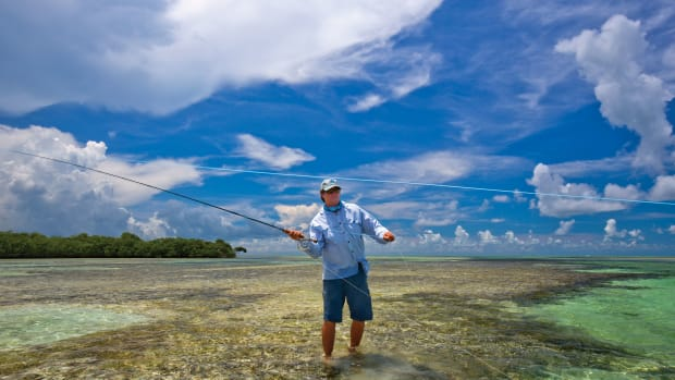 Key West guide Justin Rea is equally adept with fly rod and push-pole as he scours the flats for the wonderfully maddening permit.