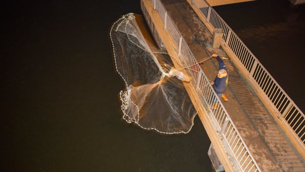 Snook sharpie Mike Thiels makes a 2 a.m. toss for bait from the Lantana Ocean Avenue Bridge in Florida