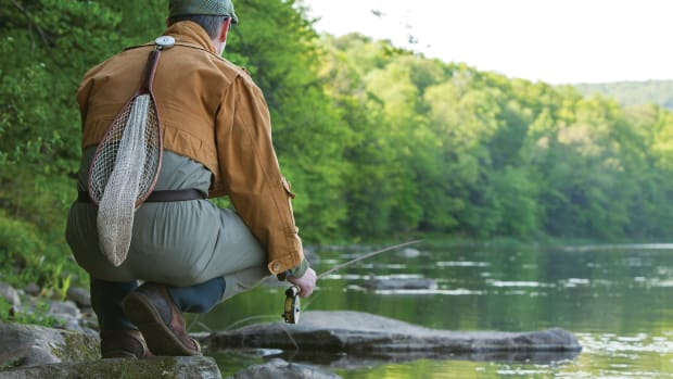 Staying low, the author scans a bank for rising trout. The demanding character of such water spurred his quest for this special rod.