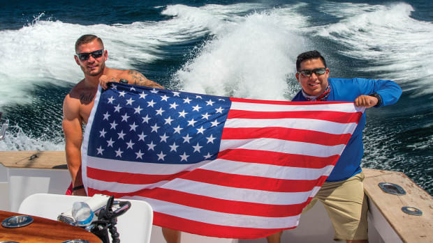 Veterans Patrick Orth (left) and Steven Diaz proudly display the colors on an offshore fishing trip.