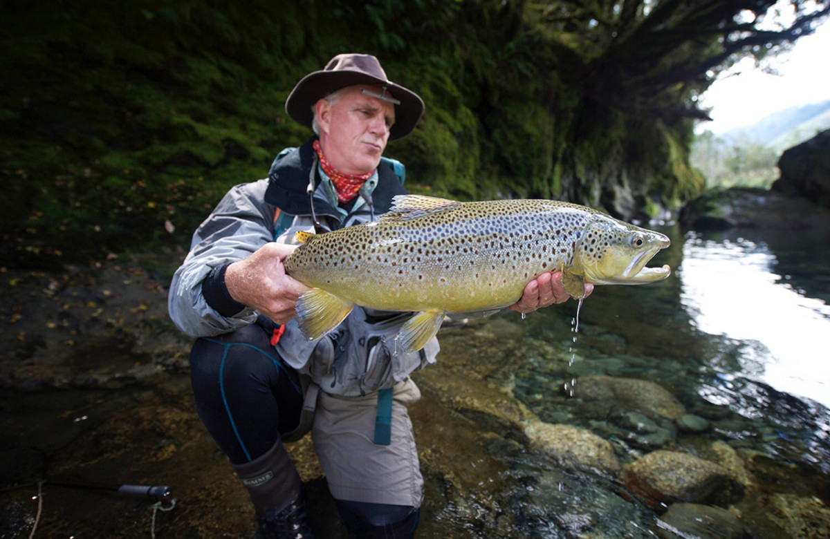 1.New Zealand guide Scott Murray holds Nick Price's 8½-pound brown trout, which tore up waterfall-like rapids with ease.