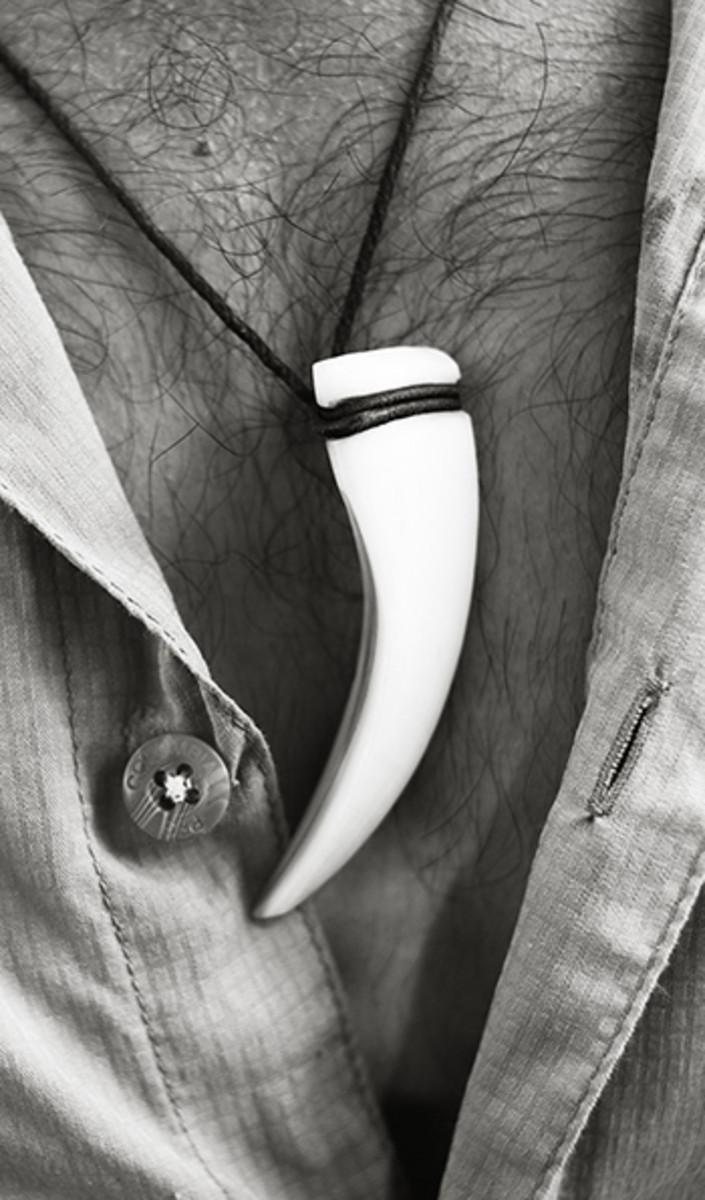 A boar tusk worn by Sebastian
