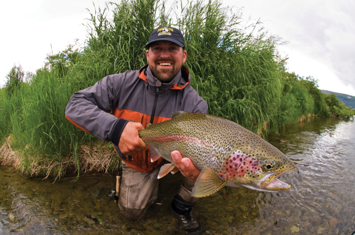 Guide Chaad McBride with a nice rainbow from the Kulik River.