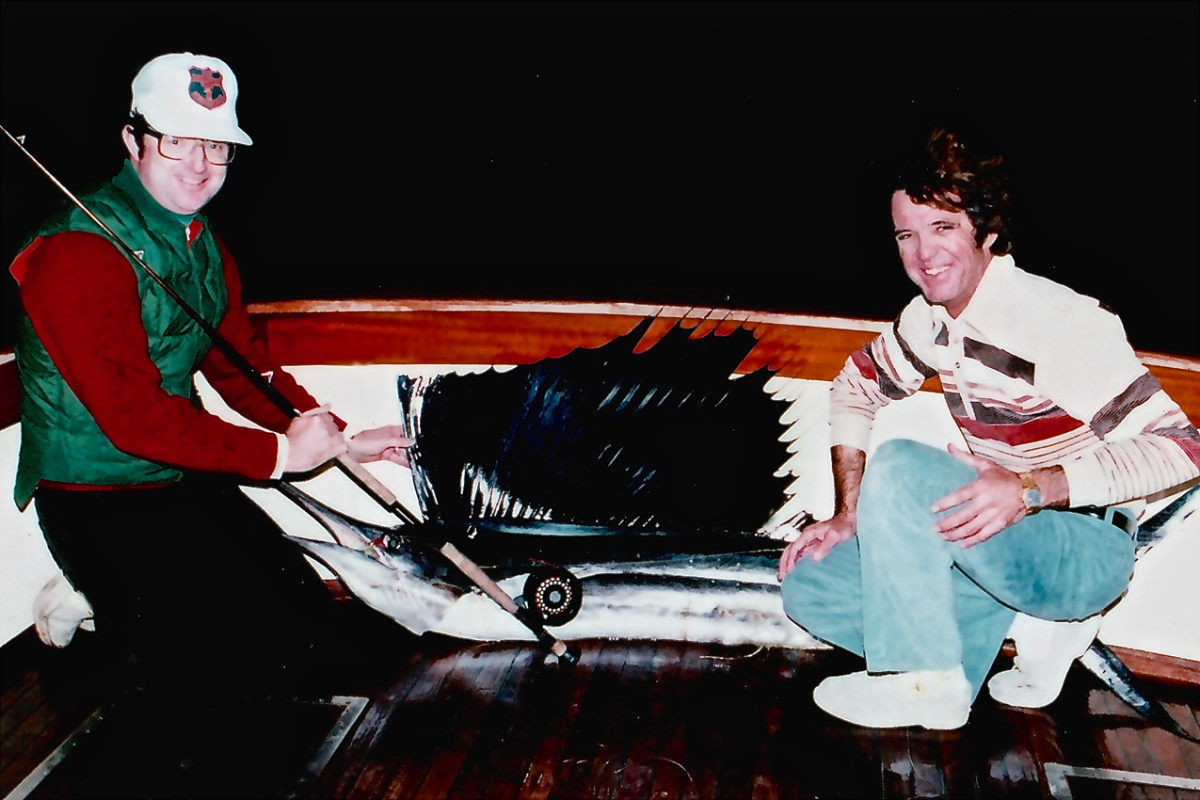 Back in the day: Pat Ford (left) and Capt. Ron Hamlin bookend Ford's record sail.