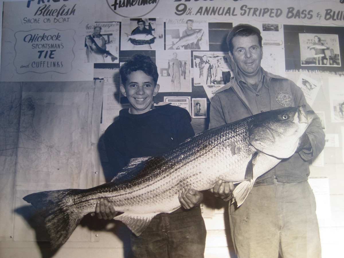 Wallace Pinkham Sr. and son with the 1954 Grand Prize fish — a 55-pound, 9.5-ounce linesider.