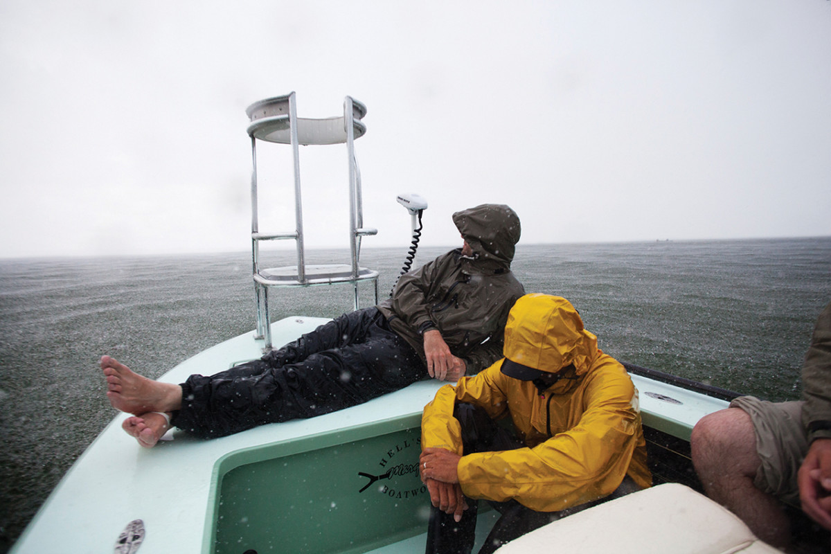 Fishing partners need a good level of compatibility. Here, friends wait out a downpour off the Keys.