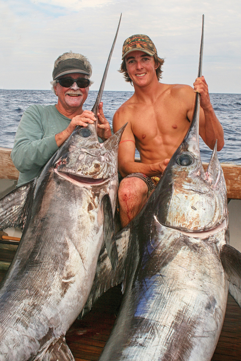 Stanczyk and his son Nick with a nice pair of swords, a fish that the family has pursued with particular vigor.