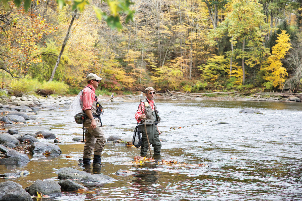 Veterans Laffin (left) and Bill Pike spent a day on the river in search of serenity and native browns.
