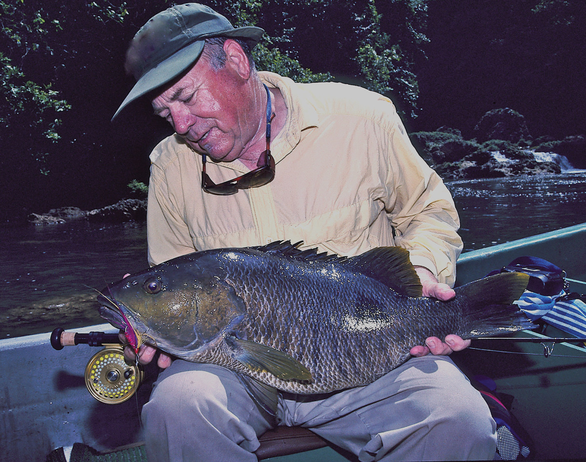 Lefty with a New Guinea Bass.