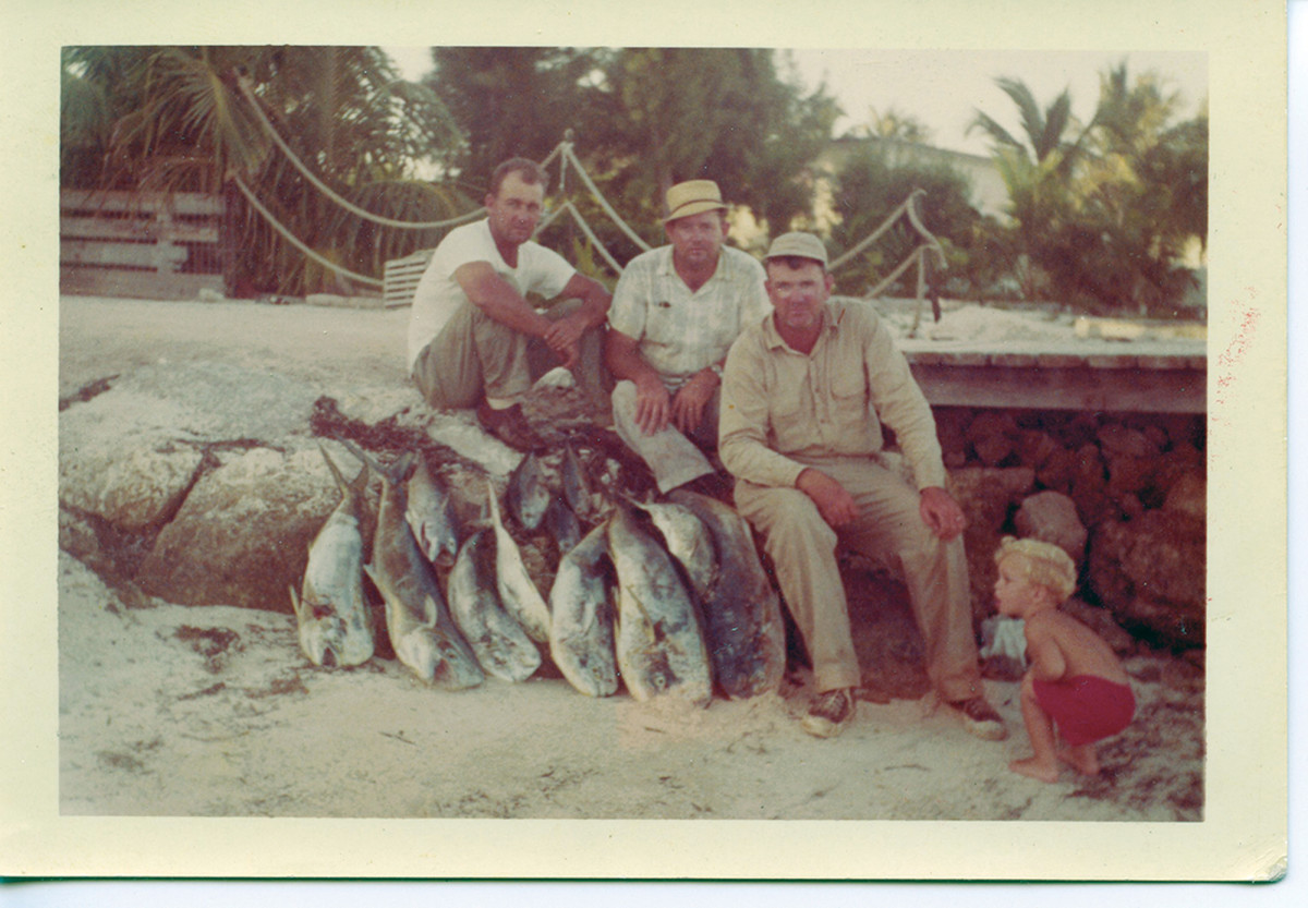 The author (in red) caught the fishing bug from his father (third from left).