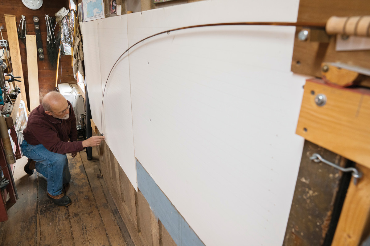 "Brandin analyzes a rod's profile on his deflection board, which he deems critical to achieving ""repeatability."