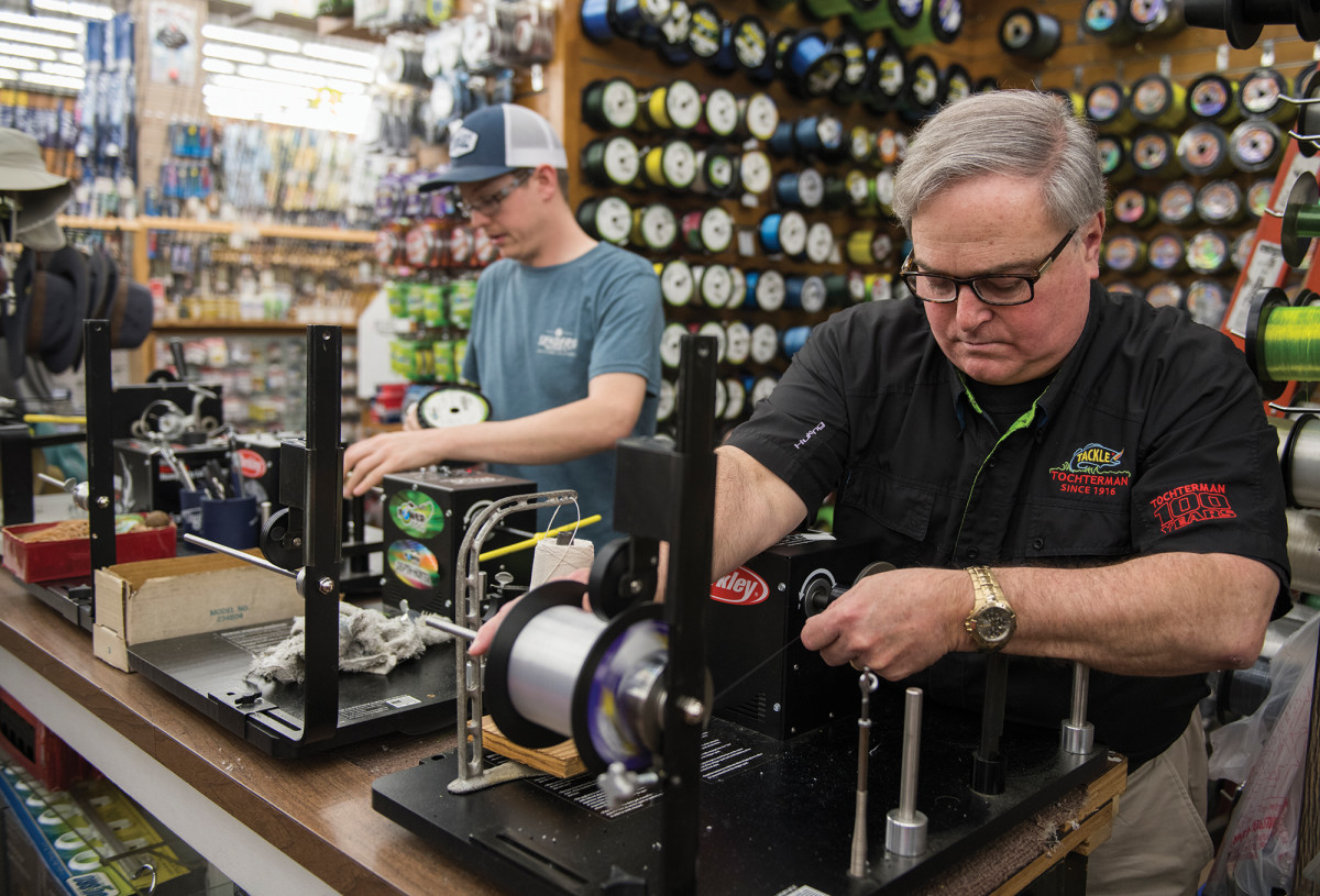 Tony Tochterman (right) and employee Ian Jones spool up reels for a customer.