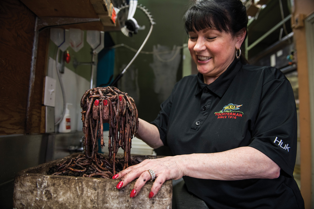 Dee Tochterman with her beloved bloodworms. Anglers come from miles around to get her prized baits, which are stored in a refrigerated brine that makes them plump and juicy.