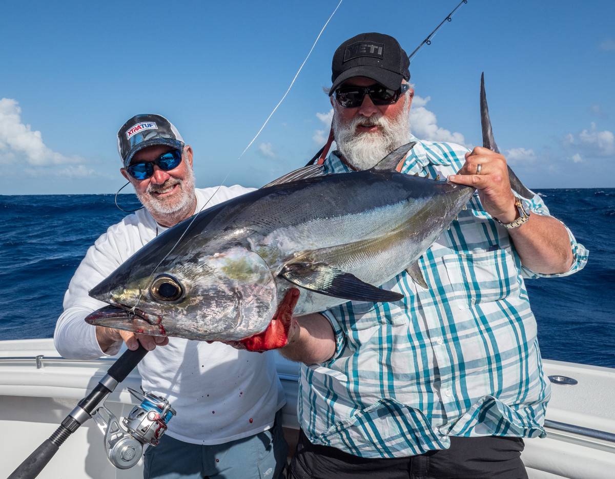 Trosset and Wakeman, a world record holder, admire a nice blackfin tuna.