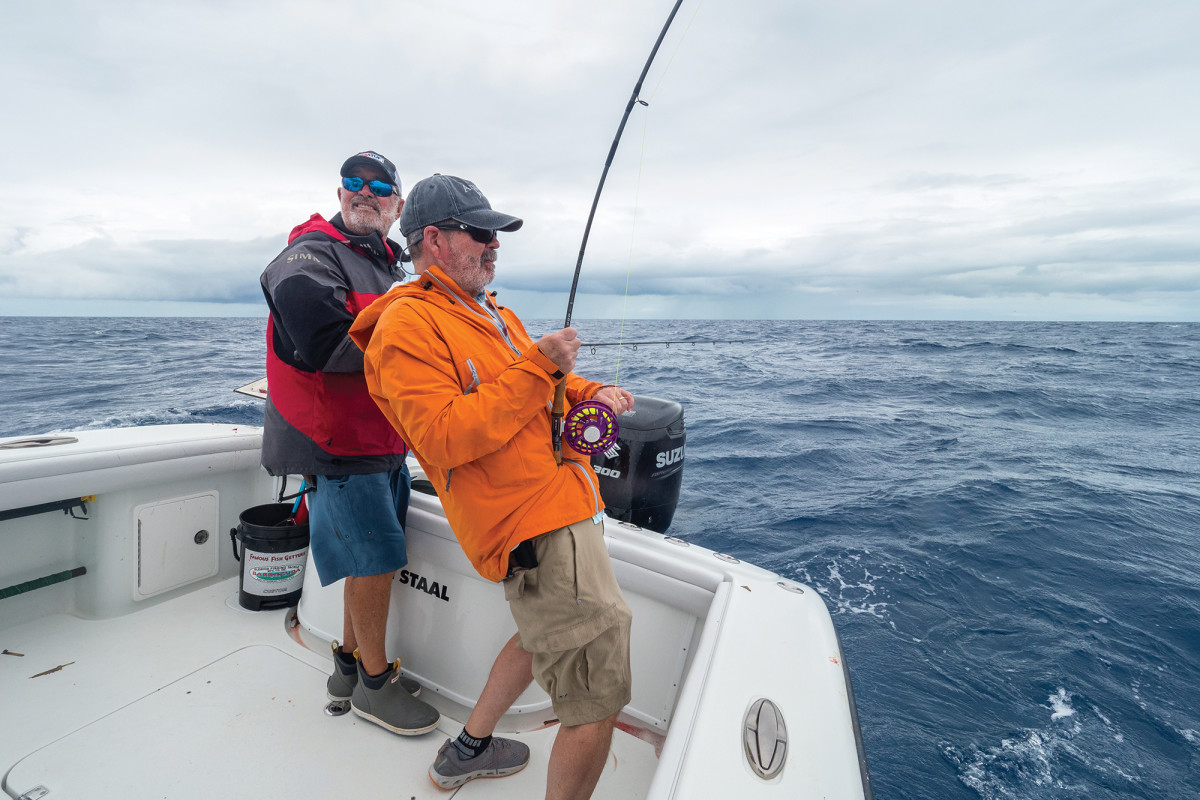 The author is fast to a fish. In three days of fishing, the trio took a bunch of tuna, kingfish, cero mackerel and more.