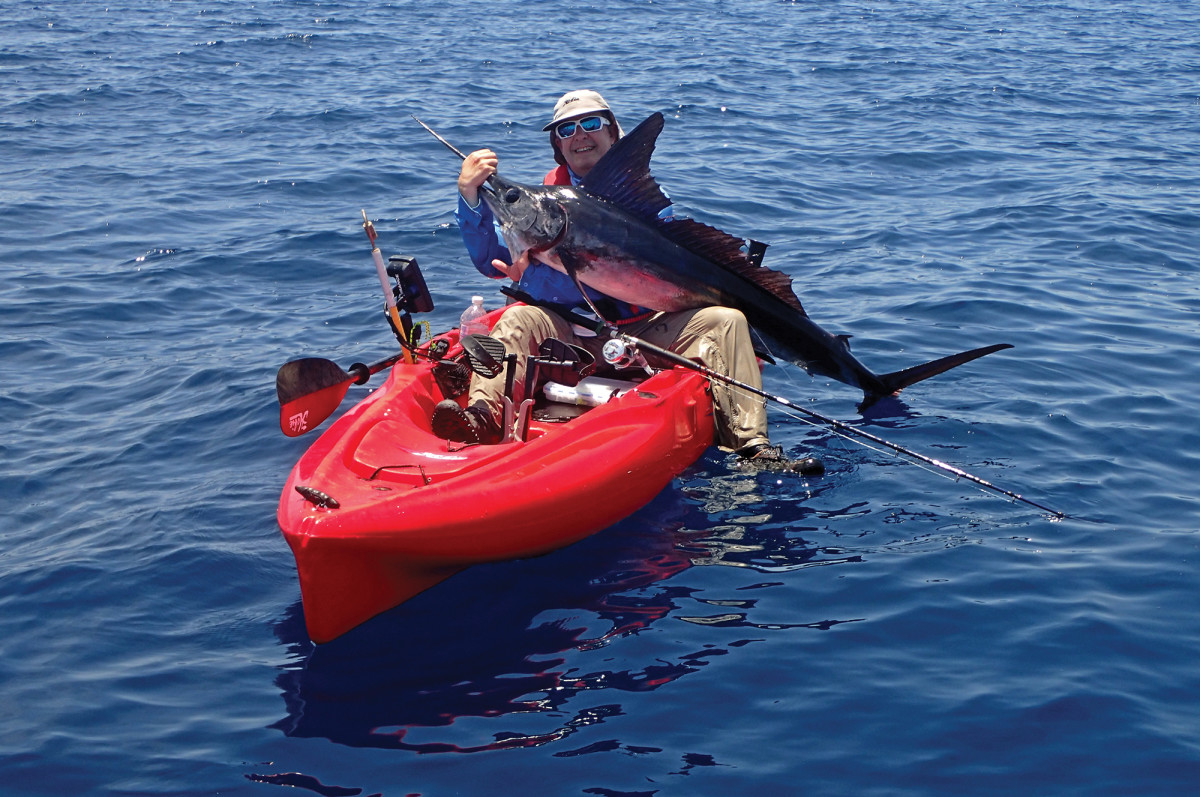 """El Dizzy"" and his improbable kayak marlin."