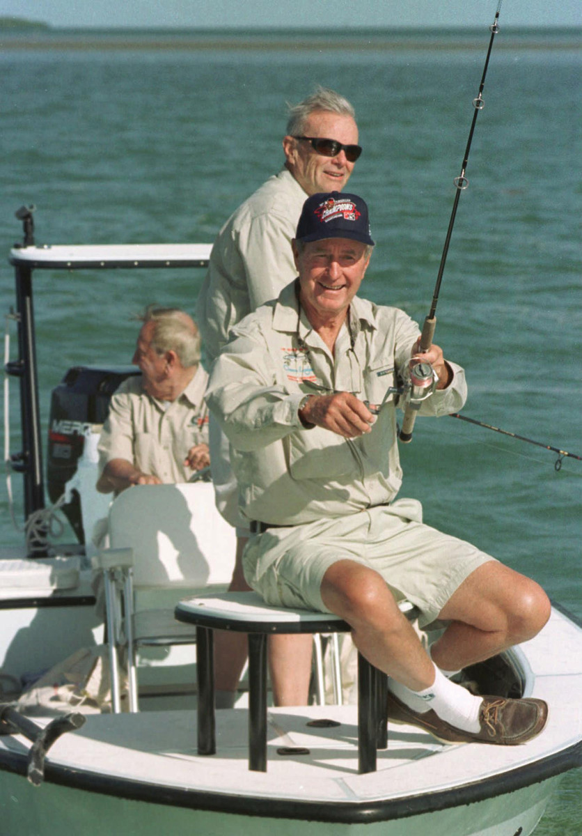 Bush fishing a tournament in the Florida Keys, with friends.