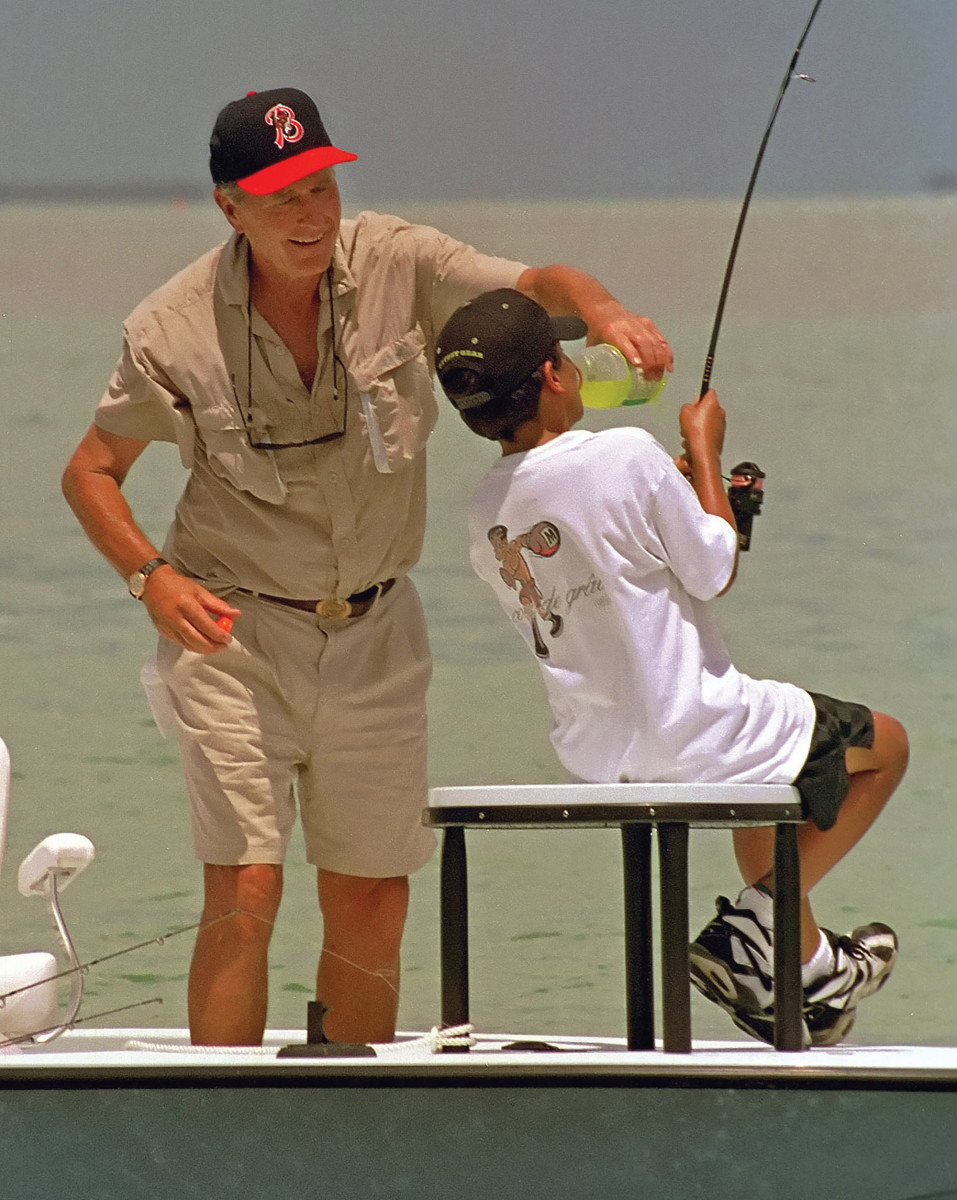 Bush fishing with grandson Jeb Bush Jr., who is fast to a large permit.