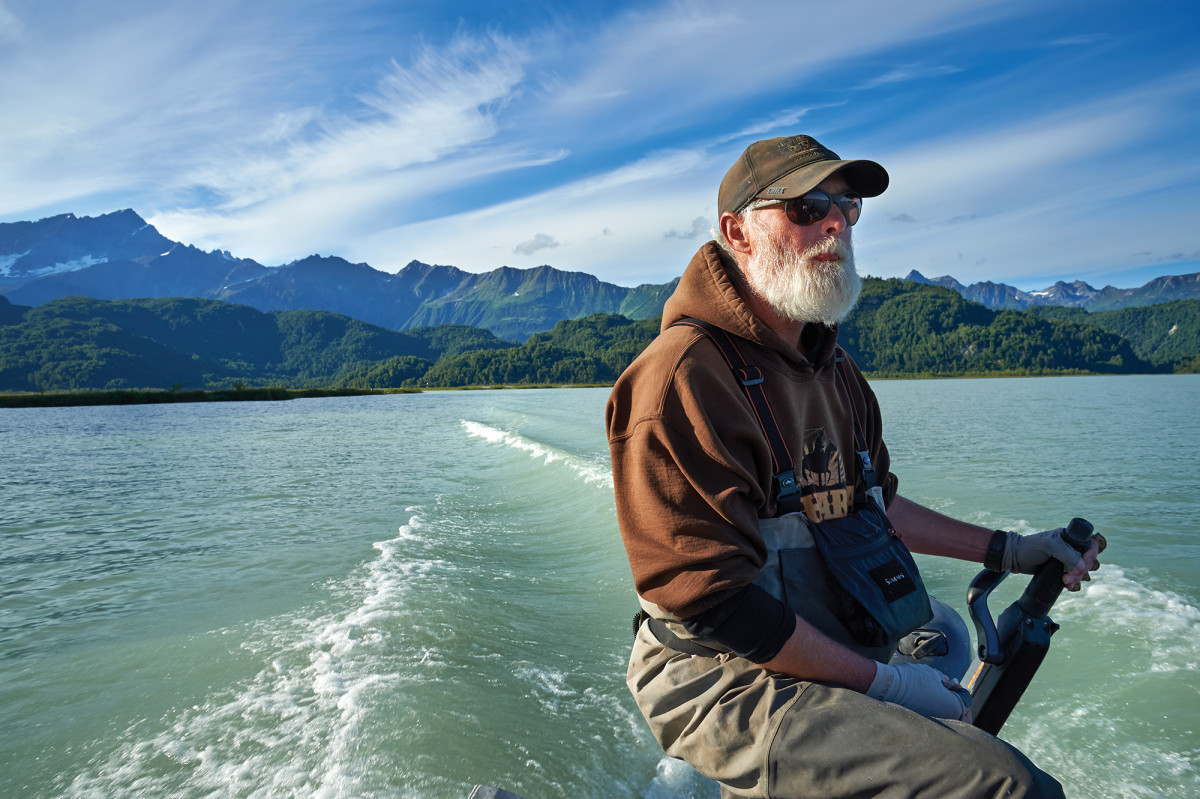 Tom Haugen, a longtime guide, on the tiller after a stellar day of fishing on Big River Lakes in the Alaska Range.
