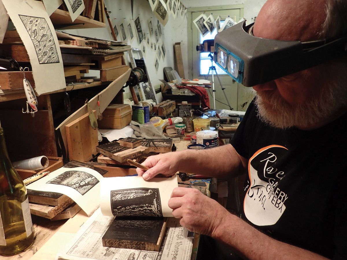 Gentry pulls up a print in his home studio in Oregon.
