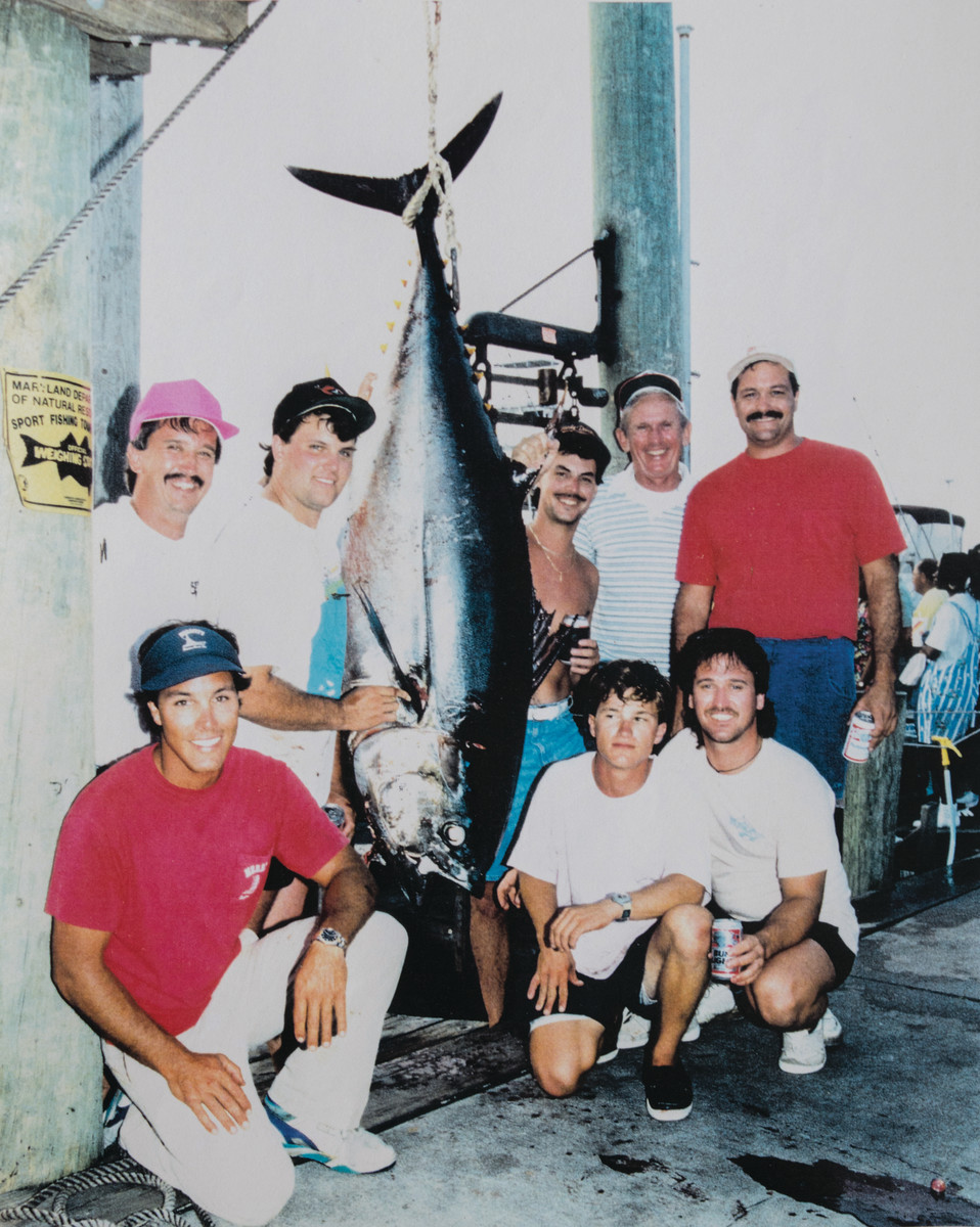 Chris (kneeling, left) was well known and loved in the fishing community.