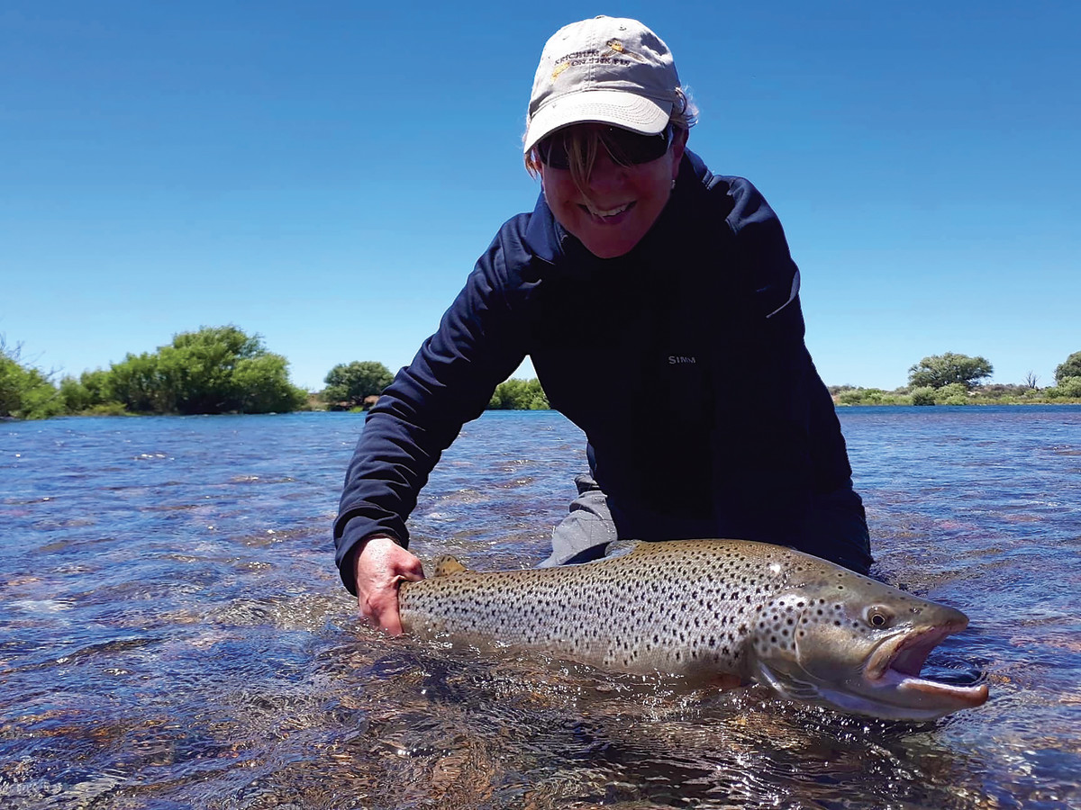 The author landed her 32-inch brown and celebrated in lodge tradition.