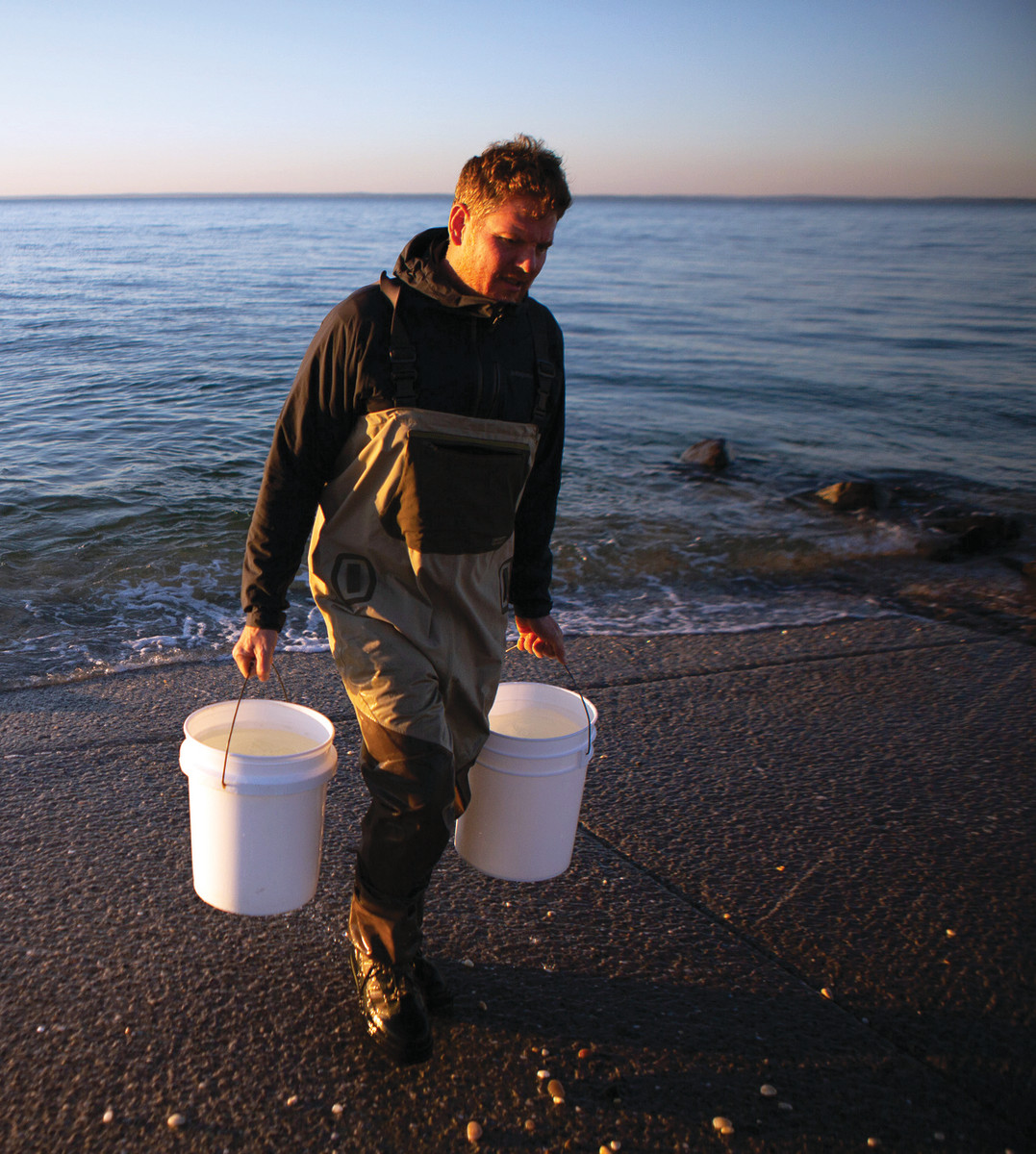 Baldwin gathers buckets of sea water in preparation for homemade sea salt.