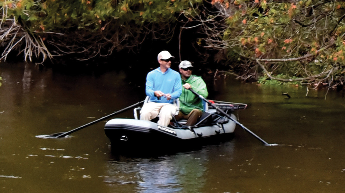 Two old friends and guides enjoy a fall float in Michigan. Alex Lafkas (fishing) is considered one of the best streamer anglers in the country.