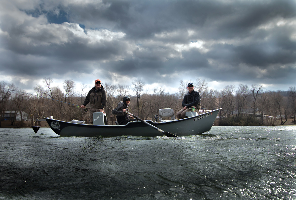 Lafkas and two clients drift for trophy browns on the White River.