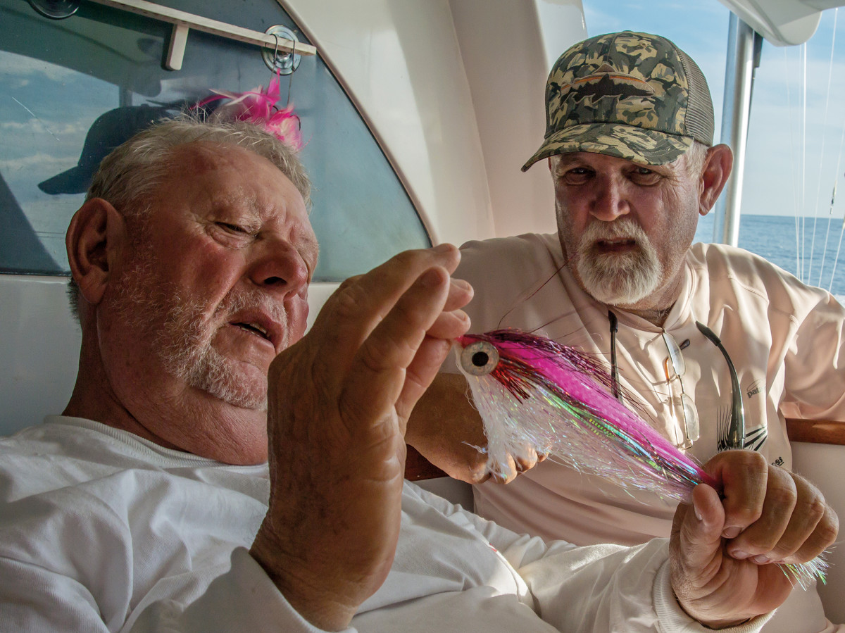 Jake Jordan (left) and North Carolina guide Brian Horsley discuss the merits of fly patterns.