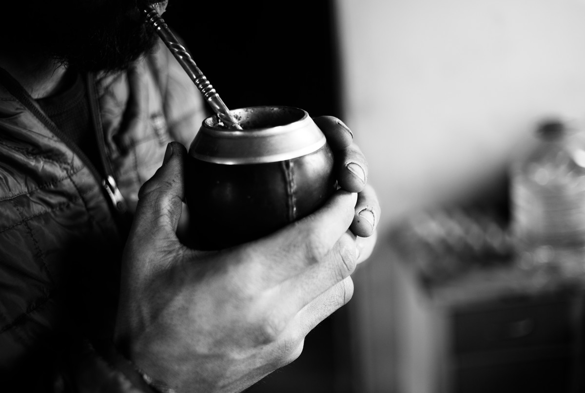 Mate, a traditional South American caffeine beverage, is served in a gourd and sipped through a metal straw called a bombilla.