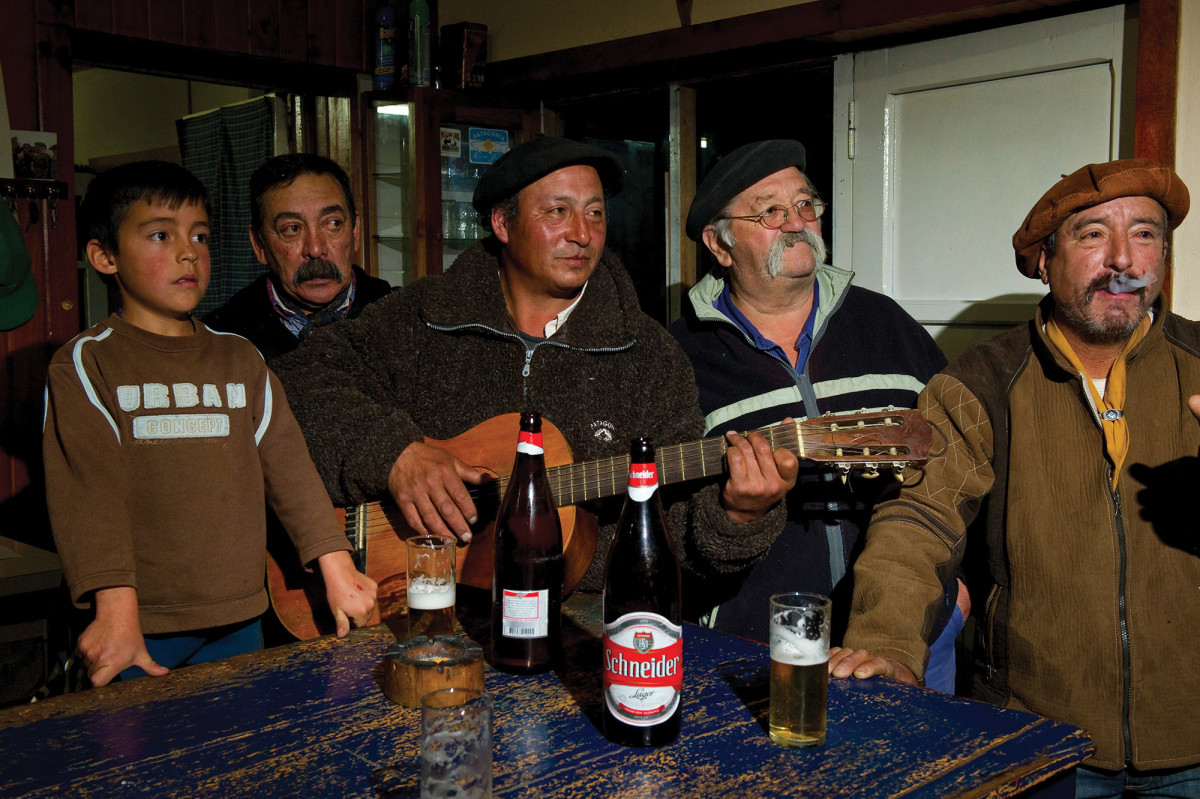 "Locals crowd ""Donkey's Bar."" The owner, Bautista Donghy, is second from left."
