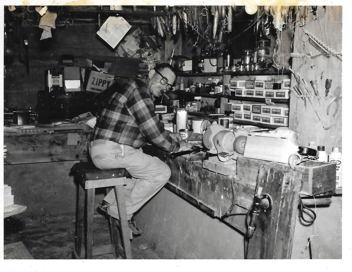"Ernest ""E.B."" Norris in his basement workshop."