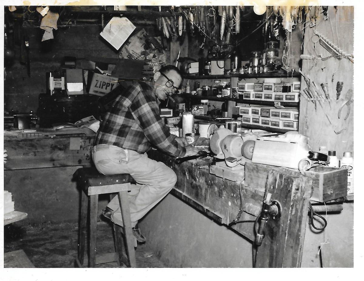 "Ernest ""E.B."" Norris in his basement workshop."
