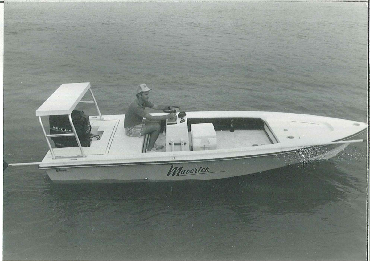 Deal at the helm of a Maverick 18 Deluxe.