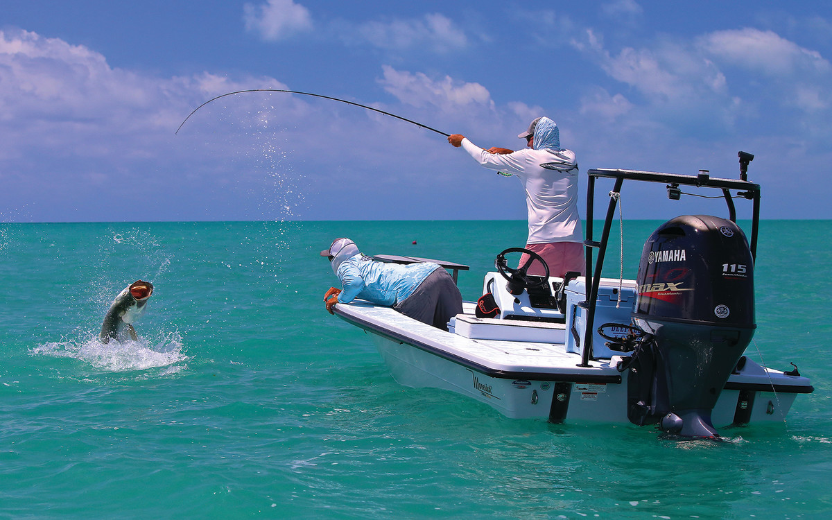An angler tangles with a tarpon from a Maverick 17 HPX-V