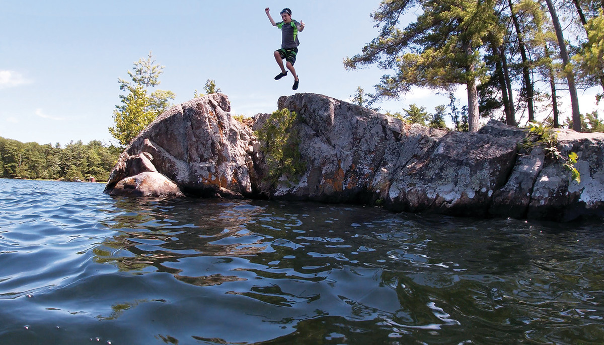 "The week at the lake includes time spent at the ""jumping rock."""
