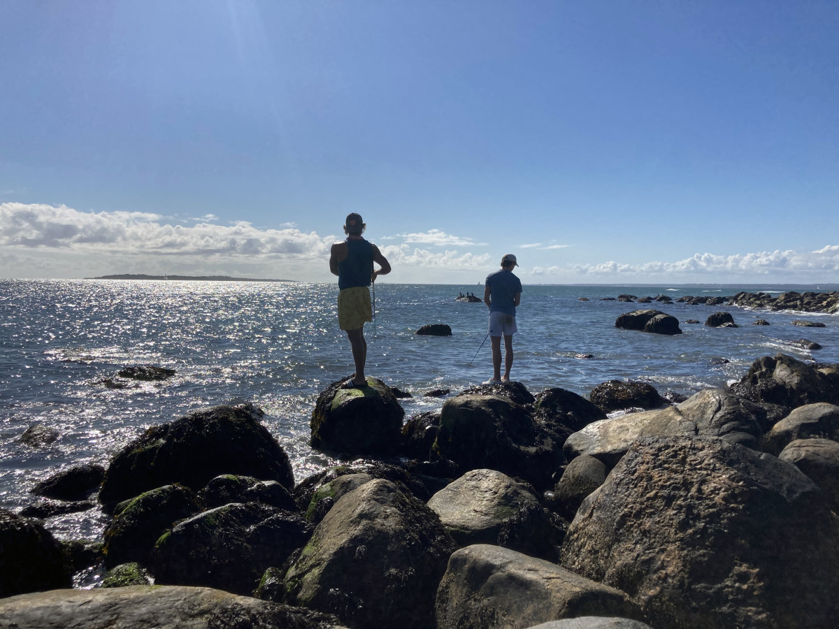Konson (L) and Balserak (R) casting for stripers on among a rock-strewn seascape.