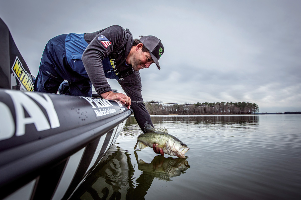 Livesay releases a fish during practice day, when the anglers plan their strategies for the tournamaent.