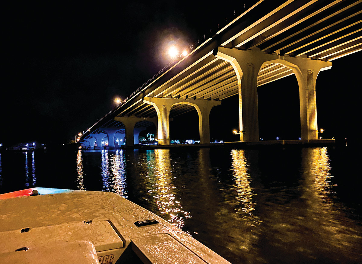 The author sought snook beneath the lights of this bridge, but a snapper came to the net instead.