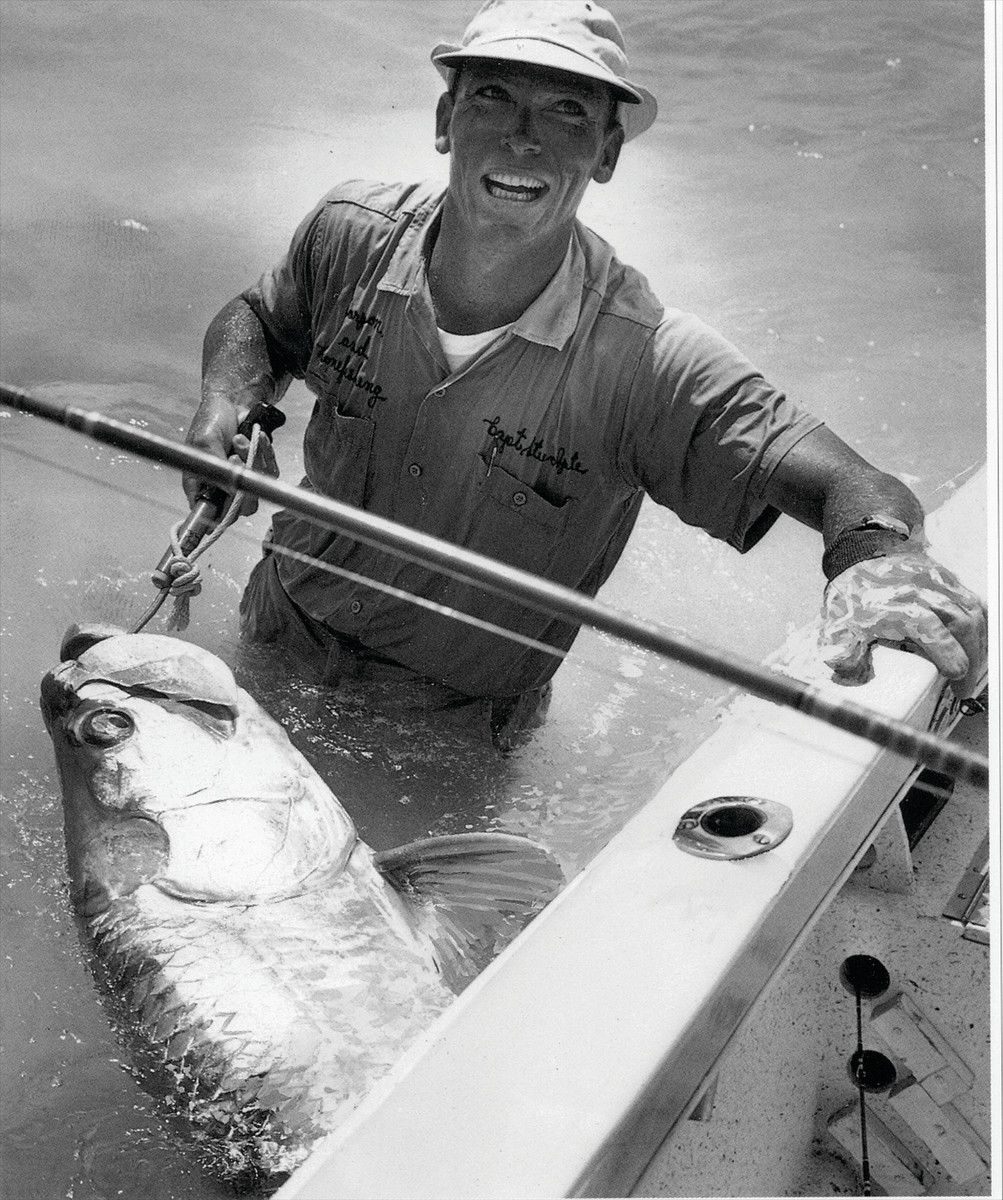 Stu Apte wound up in the drink after gaffing this trophy tarpon for Joe Brooks.