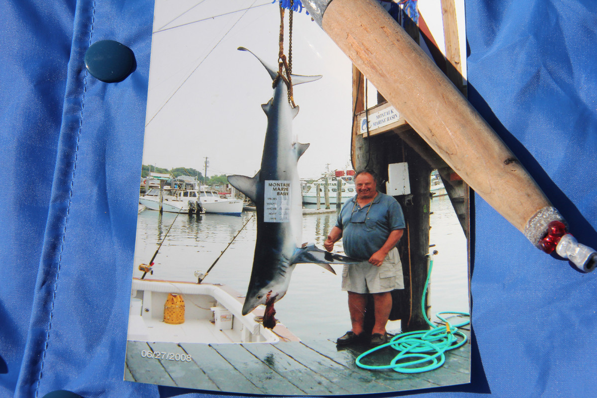 The author's stepfather, Corky Helmrich, with a blue shark that finished in the money at the Montauk Marine Basin Shark Tournament.