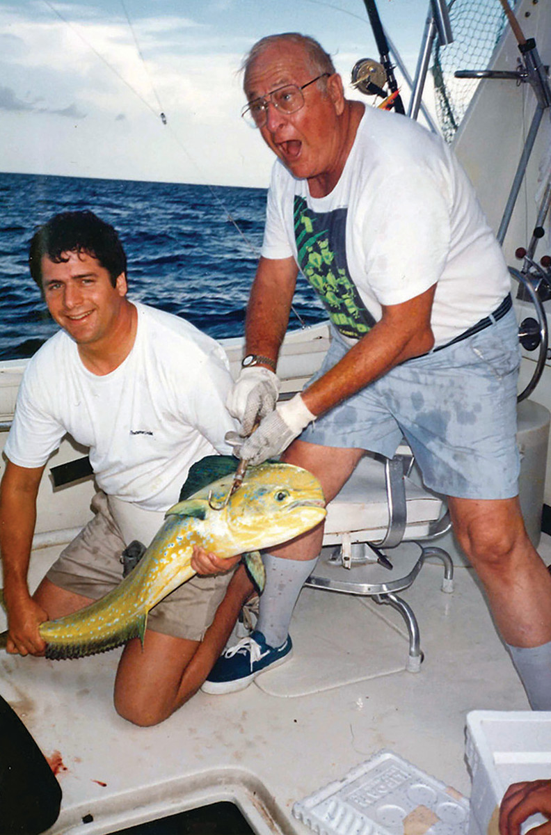 Father and son celebrate a nice mahi, one of their many catches together.