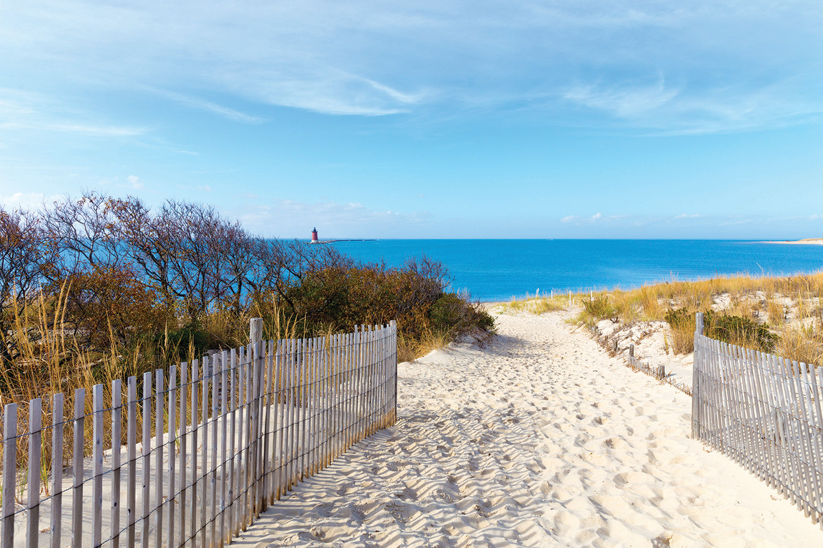 An easy hike through weathered dunes leads to the flounder grounds beyond.