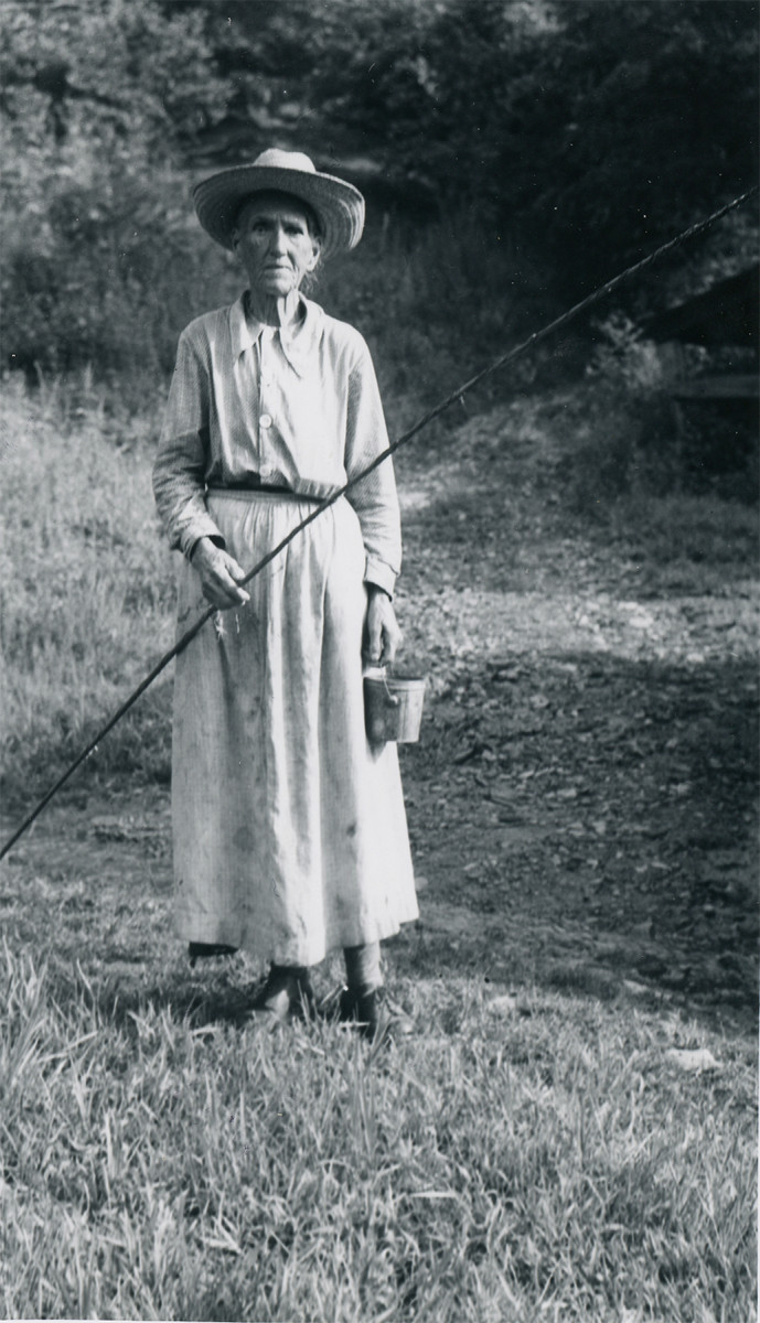 "Clem Enloe, 84, let a photographer take her picture in 1937 in Great Smoky Mountains National Park in exchange for a box of snuff, which is poking out from behind her blouse. A tough bird, she refused to observe the park's fishing regulations and instead fished year-round and with worms, which supposedly were prohibited. ""Are you a little park man or a big park man?"" she'd snap. Without undefinedwaiting for an answer, she'd say, ""Big park man or little park man, you son of a bitch. I fish when I please, winter or summer. See that can of worms?"""