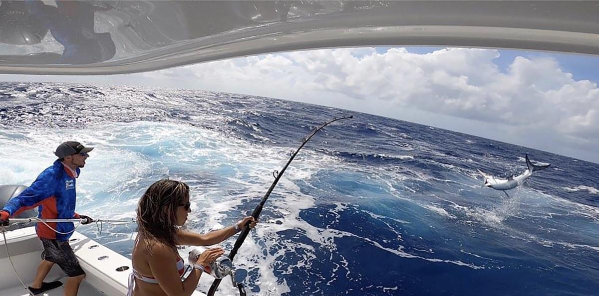 DeGruchy plays an acrobatic 130-pound swordfish.