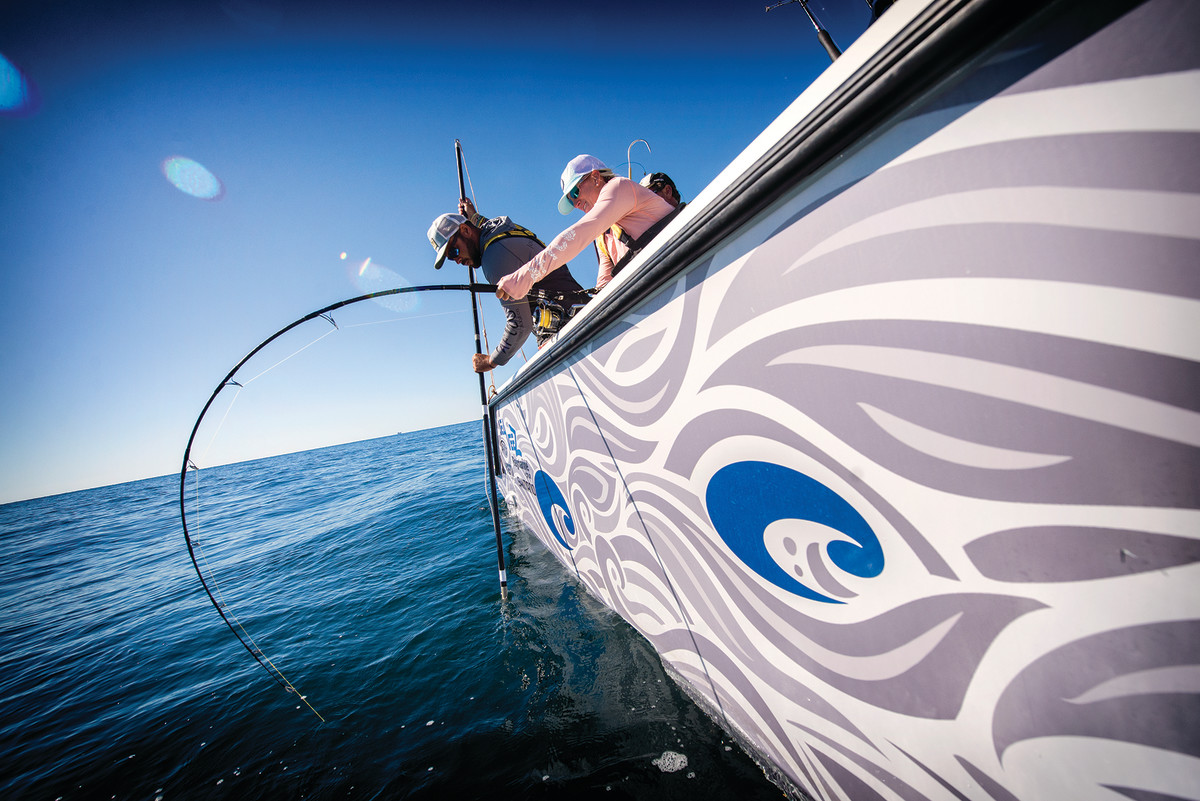 A nice yellowfin that ate a plug puts a good bend in a spinning outfit as the end draws near.