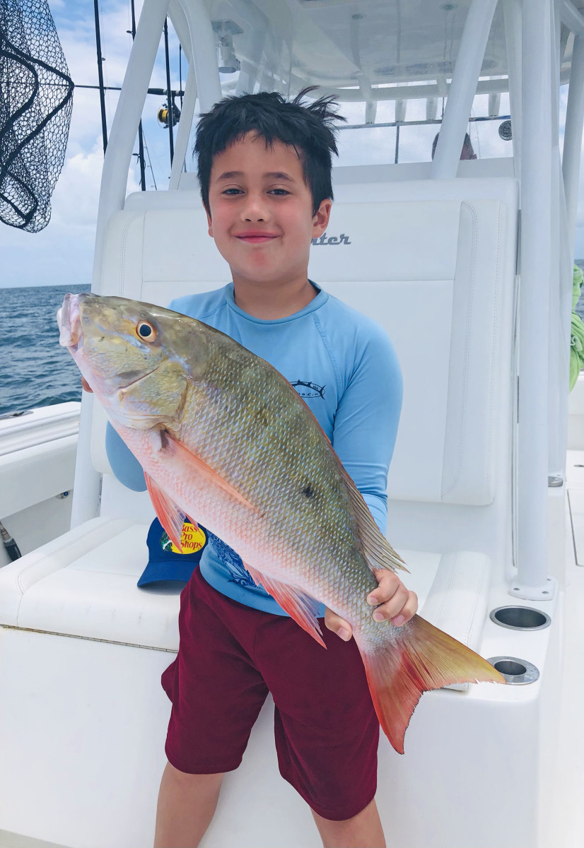 The author's son with a nice mutton snapper, ready for the table.
