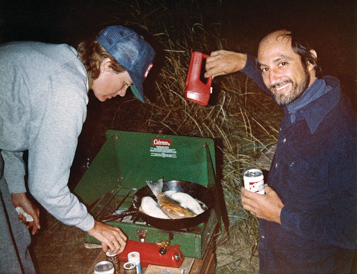 Leigh and out-of-town guest Stuart Bornstein prepare the catch of the day.
