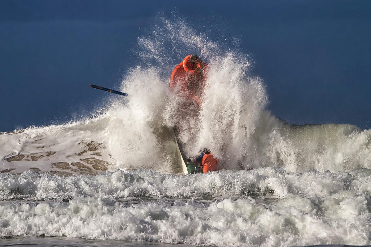 Launching small boats into heavy shore break takes experience, timing and nerve.